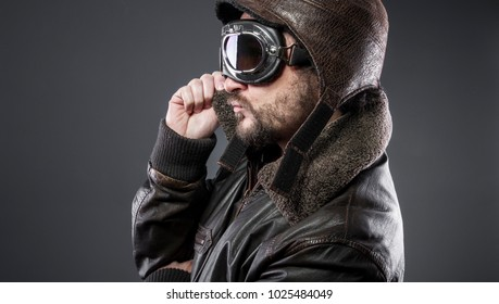 old airplane pilot with brown leather jacket, arador hat and large glasses