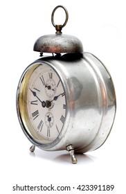 Old alarm clock isolated on white background