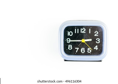 Old alarm clock isolated on the background
