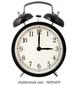 Old Alarm Clock isolated on white in black and white, showing three o'clock.
