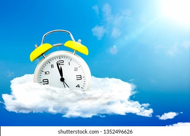 old alarm clock on clouds