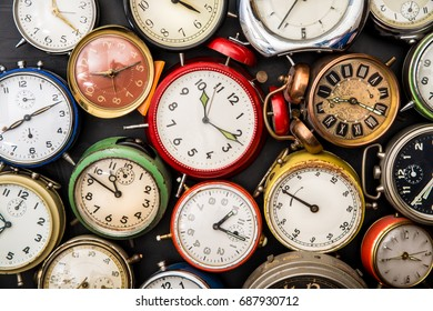 old alarm clock on dark background