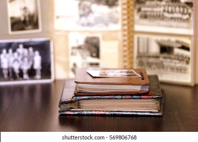 Old Albums with Black and White Nostalgic Blurry Photos in Background