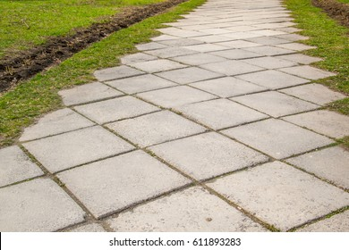 The old alley with square concrete plates