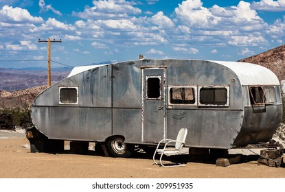 An old aluminum travel trailer in the Nevada desert