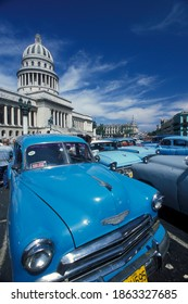 old american cars in front of the capitolio National in the city of Havana on Cuba in the caribbean sea.   Cuba, Havana, October, 2005