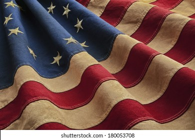 Old American flag designed during the American Revolutionary War features 13 stars to represent the original 13 colonies. According to the legend the original Betsy Ross flag was made on July 4, 1776.