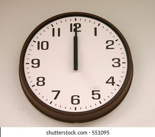 Old analog clock at midnight / lunch / 12:00.  What you would see in a public school
