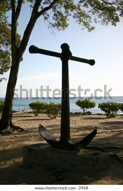 old anchor displayed on a beach