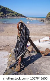 Old anchor in front of the small beach whish also is the harbour of Port Isaac in the northern part of Cornwall, England