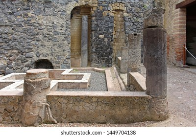 Old ancient architecture site with stone wall and columns from Roman empire
