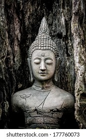 Old ancient buddha statue on wooden background