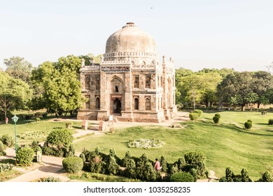 old ancient Indian stone building in the park New Delhi early morning