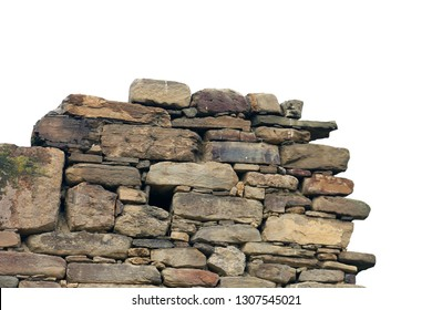 old ancient ruined stonework wall of brown and beige bricks and stone blocks foreground closeup isolated on white background