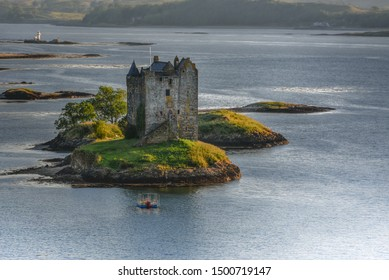 old ancient stony tower lonely on Island in lake