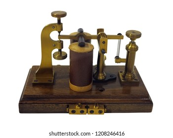 Old ancient telegraph device  on wooden table isolated over white background