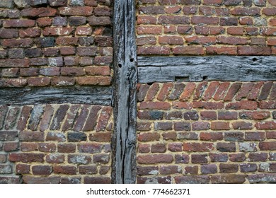 Old ancient wall with wood pattern and aged red bricks background