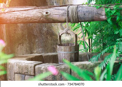 Old ancient water bucket wood vintage on the artesian wells in Thailand