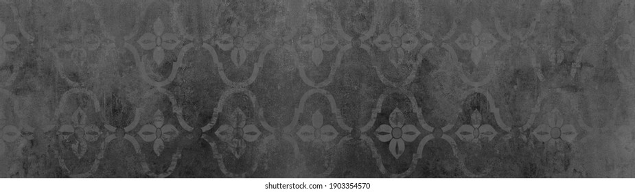 Old anthracite gray grey black vintage worn shabby elegant floral leaves flower patchwork motif tiles stone concrete cement wall wallpaper texture background banner panorama