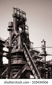 Old antique and abandoned industrial blast iron metallurgical smelting furnace steel structure in nostalgic sepia