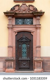 Old antique door. Beautiful old wooden door with iron ornaments
