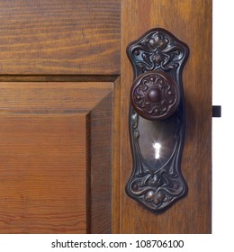 Old antique door and door handle with an illuminated key hole begging for one to see what�s on the other side