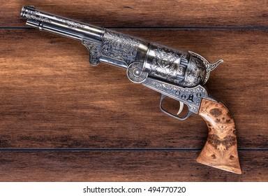 old, antique gun on a wooden background