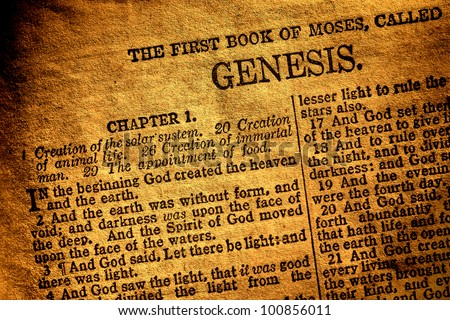 Old antique Holy Bible Christian religion book open to the first page of Moses original chapter of genesis and text about god creation of heaven and hearth in the religious Ancient Testament