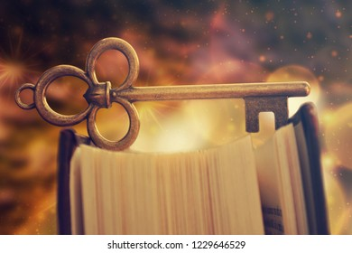 Old antique key standing on book. Education concept, reading is the key.