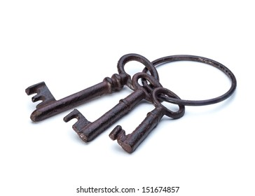 Old antique keys isolated on a white background closeup