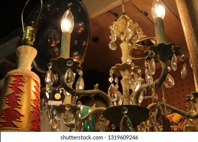 old antique lamp with other misc. glass silver and gold items around it. vintage background.