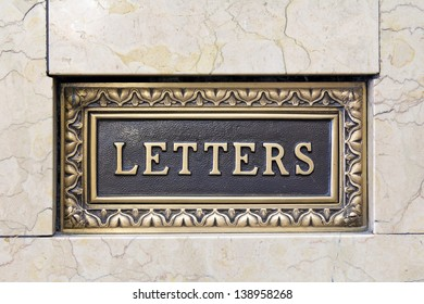 Old Antique Letter Mail Box in Marble Wall