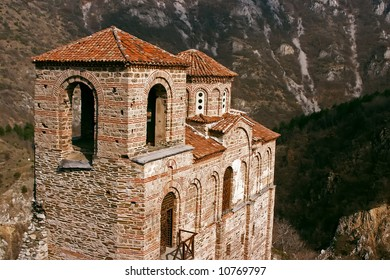 Old antique ortodox church in mountains with trees