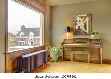 Old antique piano and living room with the view of the English house.