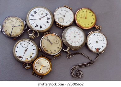 Old antique pocket watch on a gray background. Old watches are sold on the flea market.