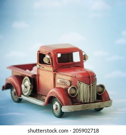 Old antique toy truck carrying sweet candy