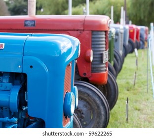 Old antique tractors in lineup at agricultural show
