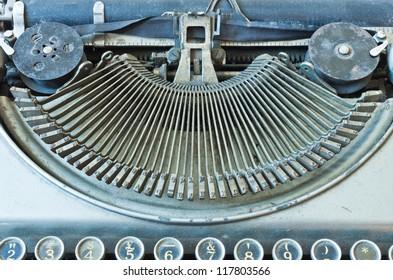 Old Antique typewriter keyboard isolated on white