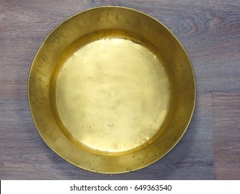 Old antique vintage gold bowl. Close-up of golden empty bowl