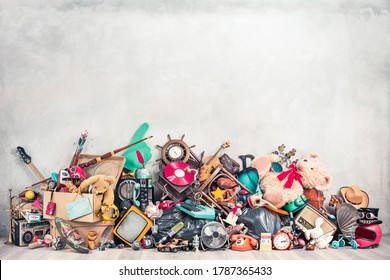 Old antiques and retro collectibles memorabilia dumped in a huge pile. Garage sale, attic room storage conceptual still life or disposal and recycling of outdated objects. Vintage style filtered photo - Shutterstock ID 1787365433