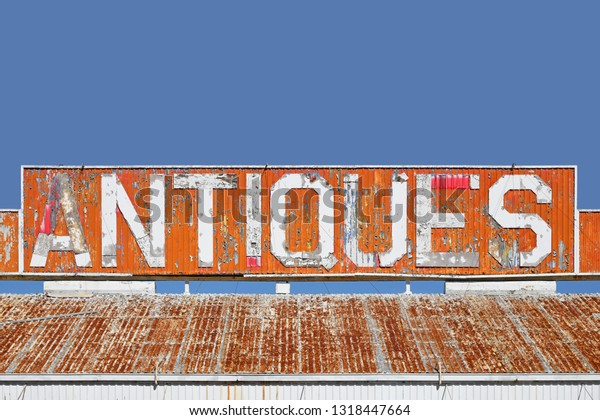 old-antiques-sign-on-roof-600w-131844766