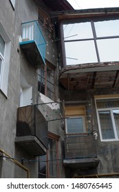 Old apartaments with balcony and windows in the city
