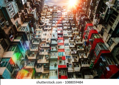 Old apartment with sunbeams shining through old building in Hong Kong