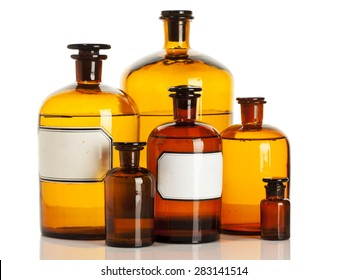 Old apothecary bottles of different sizes isolated on white background