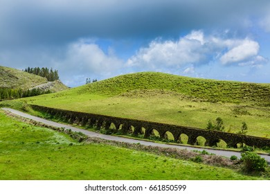 Old aqueduct at Blue Lake. Blue and green lakes are located in the volcano craters of the island of Sao Miguel, part of the Azores.