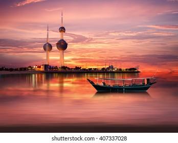 An old Arabian boat docked in front of Kuwait Landmark