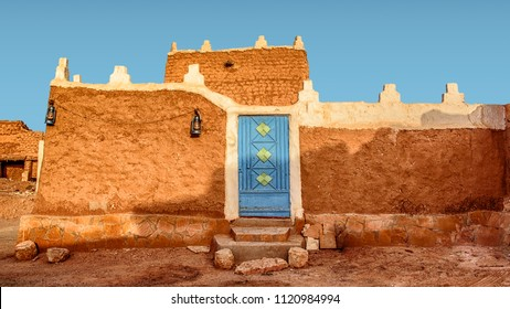 Old Arabic House with Door and Antique Lanterns - Traditional Arab Mud Architecture - Part of an Old Fort – Home Made of Sand – Saudi Old Traditional House at Morning - Riyadh - Diriyah, Saudi Arabia