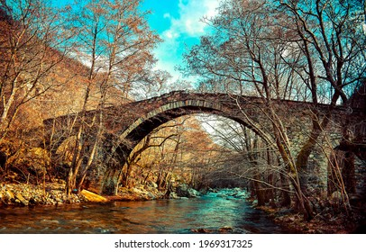 Old arch bridge in the autumn forest. Arch bridge in forest. Autumn forest arch bridge. Stone bridge in autumn forest - Shutterstock ID 1969317325