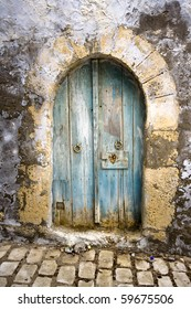 Old arched door in North Africa