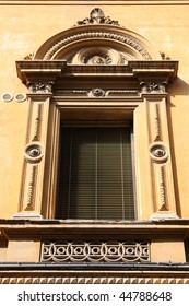 Old architecture in Bologna, Italy. Ornamental window.